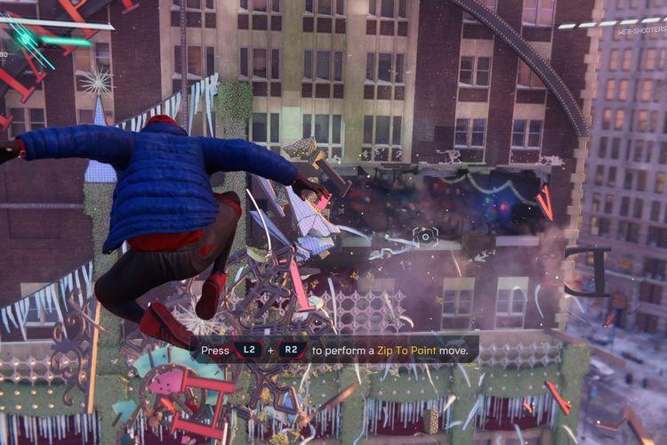 Tampilan Spider-Man: Miles Morales dengan karakter yang sedang bergaya di udara.