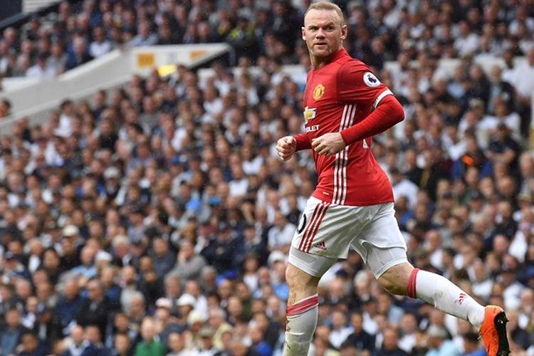 Ekspresi penyerang Manchester United, Wayne Rooney, seusai mencetak gol dalam pertandingan melawan Tottenham Hotspurdi White Hart Lane in London, pada 14 Mei 2018.