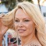 Kisah Cinta Adil Rami dengan Pamela Anderson
