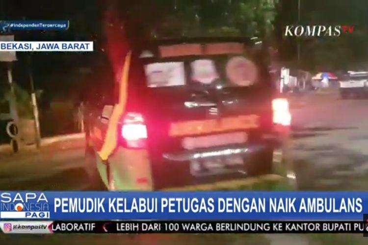 Tangkapan layar Kompas TV, lima orang hendak mudik menggunakan ambulans. Aksi pemudik ini terungkap ketika sedang melintas di Jalan Pantura, Kedungwaringin, Kabupaten Bekasi, Jumat (7/5/2021).