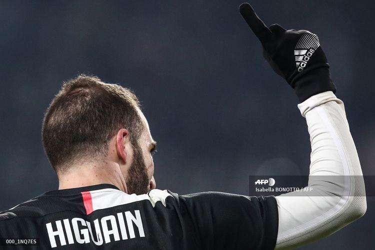 Bomber Juventus, Gonzalo Higuain, merayakan gol pembuka pada laga Coppa Italia kontra Udinese di Juventus Stadium, Turin, pada Kamis (16/1/2020) pagi WIB.