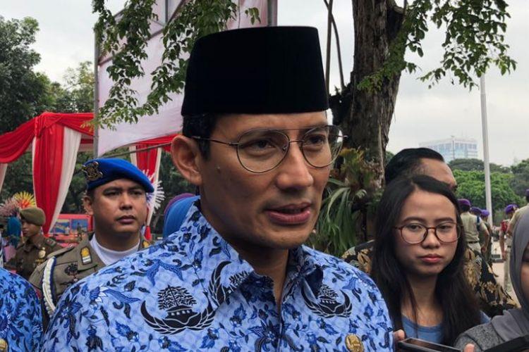Wakil Gubernur DKI Jakarta Sandiaga Uno usai memimpin apel Hari Otonomi Daerah di Lapangan Eks IRTI Monas, Rabu (25/4/2018).