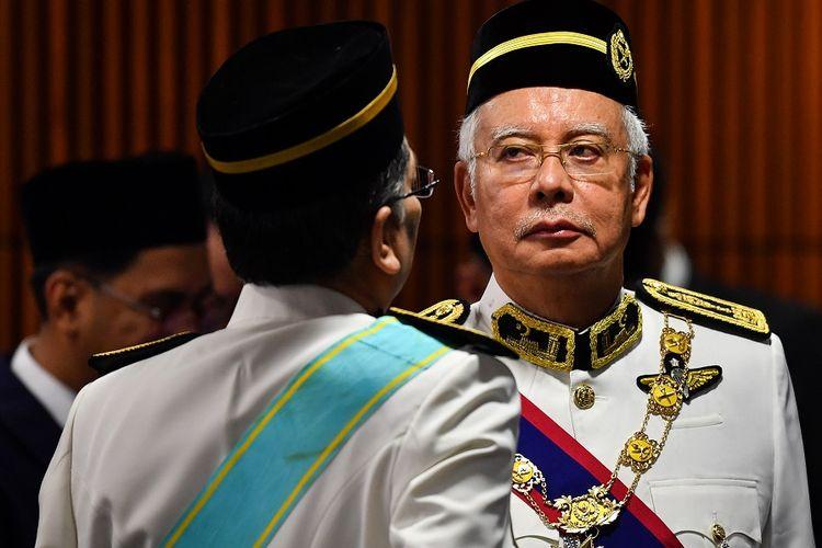 Mantan Perdana Menteri Malaysia Najib Razak ketika menghadiri upacara pembukaan Parlemen Malaysia di Kuala Lumpur, Selasa (17/7/2018). Najib kini menjadi anggota parlemen dari barisan oposisi.