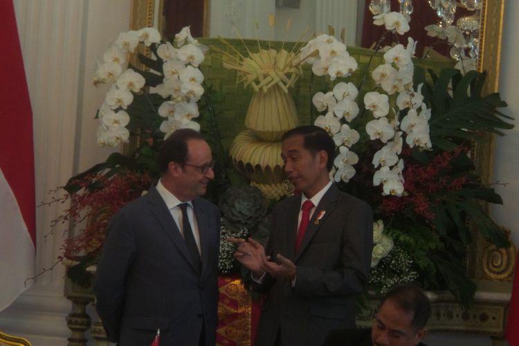 Presiden Joko Widodo dan Presiden Republik Perancis Francois Hollande saat aara penandatanganan lima MoU di Istana Merdeka, Jakarta, Rabu (29/3/2017).