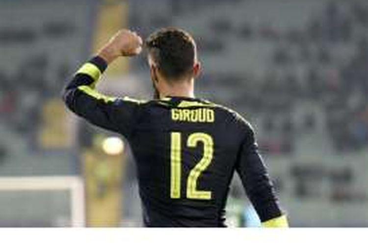 Striker Arsenal, Olivier Giroud, melakukan selebrasi setelah mencetak gol ke gawang Ludogorets pada pertandingan penyisihan Grup A Liga Champions di Stadion Vassil Levski, Sofia, Selasa (1/11/2016).