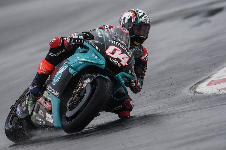 Andrea Dovizioso saat berlaga pada MotoGP San Marino 2021. (Photo by ANDREAS SOLARO / AFP)
