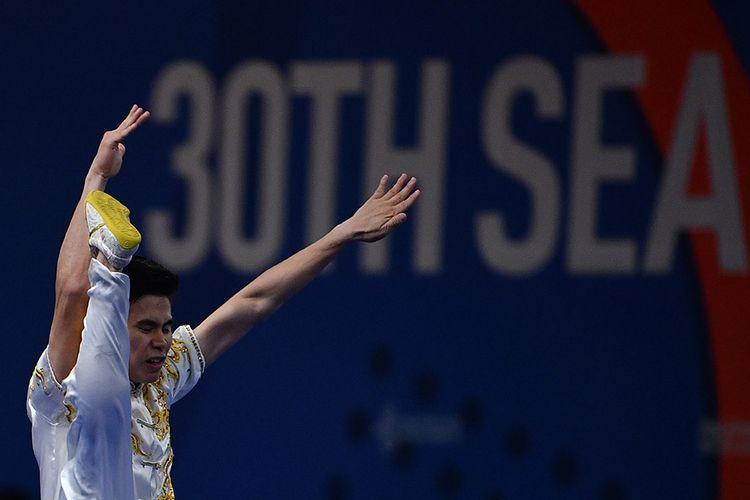 Atlet wushu putra Indonesia Edgar Xavier mengikuti final wushu taolu changquan putra SEA Games 2019 di World Trade Center, Manila, Filipina, Minggu (1/12/2019). Edgar gagal meraih medali berada di posisi keempat dengan skor 9,59.