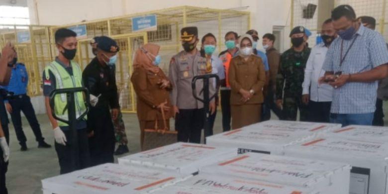 Members of the Indonesian Police and Military escort the Covid-19 vaccine from Sinovac Biotech Ltd in Halu Oleo Airport in Kendari, Southeast Sulawesi.