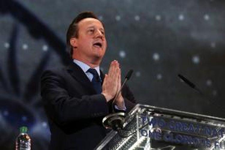 Perdana Menteri Inggris David Cameron saat berpidato menyambut PM India Narendra Modi di Stadion Wembley, London, Jumat (13/11/2015).