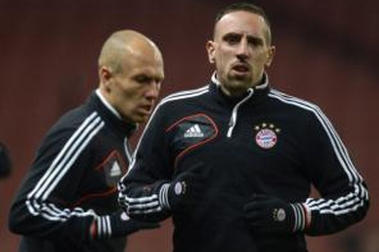 Dua pemain Bayern Muenchen, Arjen Robben (kiri) dan Franck Ribery (kanan).