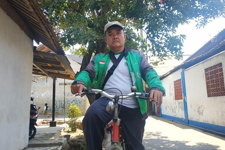Eko Susilo (47), driver Go-Food pengguna sepeda.