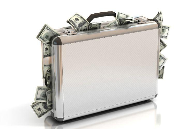 Ilustrasi koper penuh dengan uang.