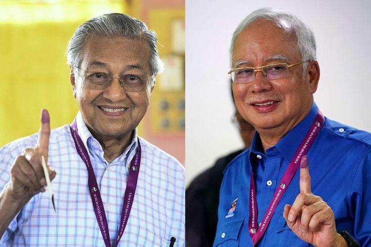 Politisi senior Malaysia Mahathir Mohamad (kiri) dan Perdana Menteri Malaysia Najib Razak menunjukkan jarinya yang bertinta setelah memberikan suaranya dalam pemilhan umum, di tempat pemungutan suara di Malaysia, Rabu (9/5/2018). Pemilu yang berlangsung hari ini menjadi pertarungan sengit Perdana Menteri Petahana Najib Razak, dan mantan PM Mahathir Mohamad.