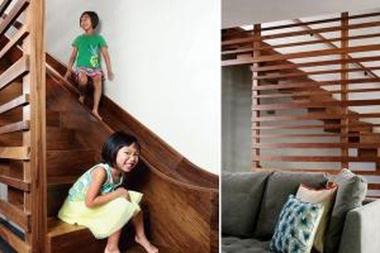 Ide segar buatan arsitek Julie Fisher ini bisa Anda terapkan dalam desain rumah Anda. Fisher membuat tangga hibrida yang tidak hanya memiliki anak tangga, namun juga perosotan.