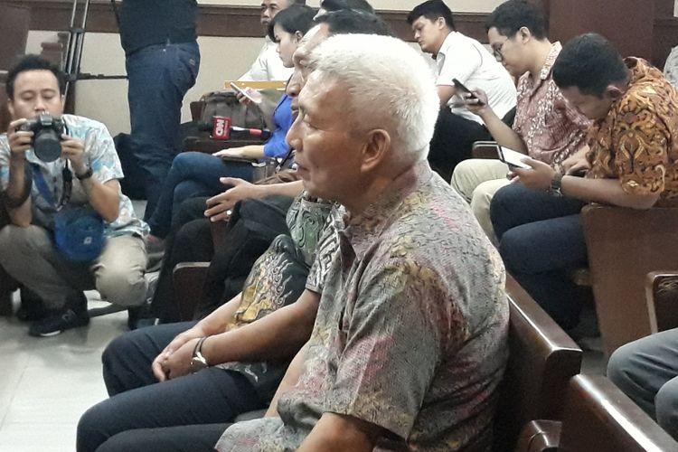 Bendahara Umum Komite Olahraga Nasional Indonesia (KONI) Jhonny E Awuy menjadi terdakwa di Pengadilan Tipikor Jakarta, Senin (11/3/2019).