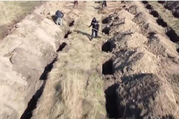 Pastikan Warganya Diam di Rumah Selama Covid-19, Kota di Ukraina Gali Ratusan Makam