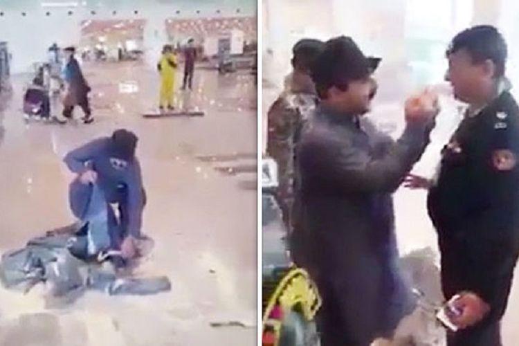 Potongan gambar memperlihatkan seorang penumpang membakar barang bawaannya, dan penumpang itu membentuk gestur terborgol ketika polisi menghampirinya.