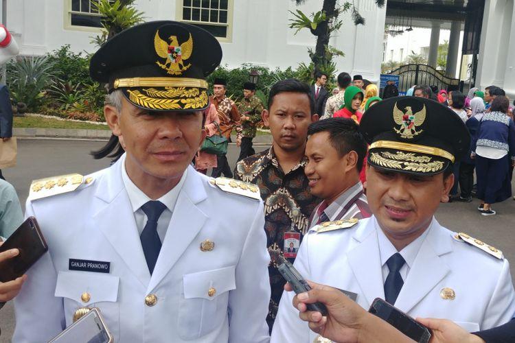 Gubernur dan Wakil Gubernur Jawa Tengah Ganjar Pranowo dan Taj Yasin usai dilantik Presiden Jokowi di Istana Negara, Jakarta, Rabu (5/9/2018).