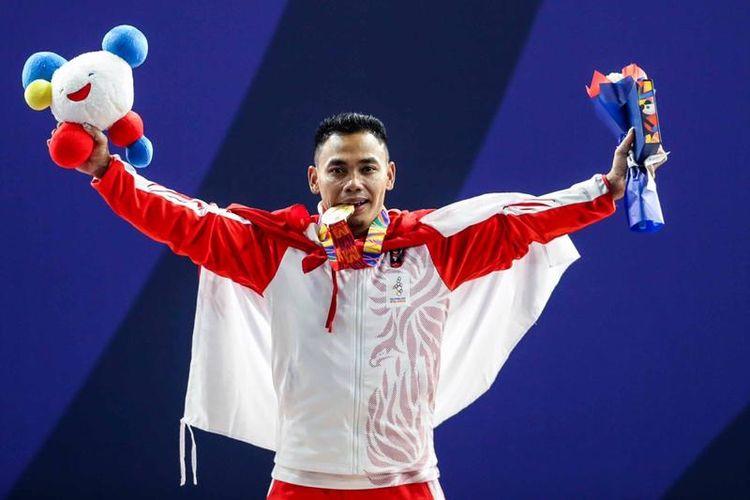 Atlet angkat besi kelas 61 kilogram, Eko Yuli Irawan, sukses menyabet medali emas di SEA Games 2019.