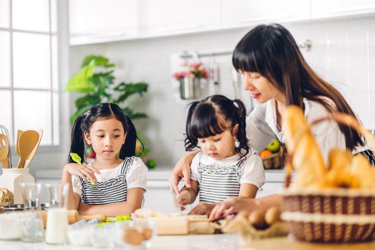 Ilustrasi ibu dan anak memasak