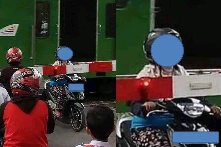 Seorang pengemudi motor yang terjebak di perlintasan kereta api beredar di media sosial pada Jumat (9/8/2019).