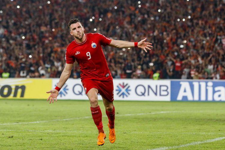 Pemain Persija Jakarta Marko Simic melakukan selebrasi saat mencetak gol saat Penyisihan grup AFC CUP 2018 di Stadion Utama Gelora Bung Karno, Jakarta, Selasa (10/4/2018). Persija menang dengan skor 4-0.