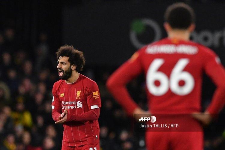 Mohamed Salah menyemangati rekan-rekannya dalam laga Watford vs Liverpool pada pekan ke-28 Liga Inggris.