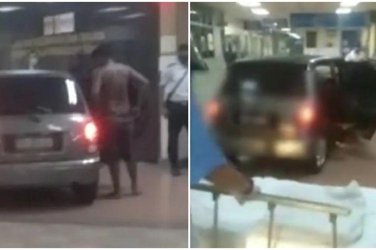 Tangkapan layar dari video mobil Perodua Kelisa abu-abu menerobos masuk lobi Unit Gawat Darurat (UGD) di Rumah Sakit Raja Permaisuri Bainun, kota Ipoh, negara bagian Perak, Malaysia, Sabtu (4/9/2021).