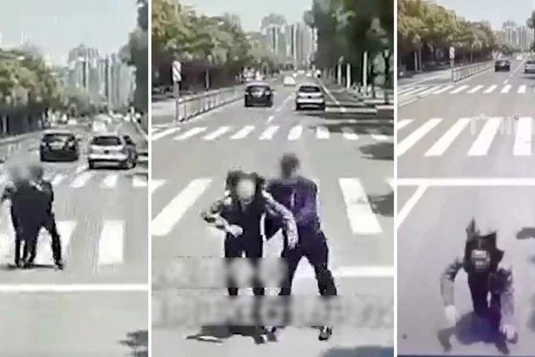 Potongan gambar dari video di dalam bus memperlihatkan seorang pria mendorong pacarnya ke arah bus yang sedang melintas saat mereka bertengkar di jalanan.