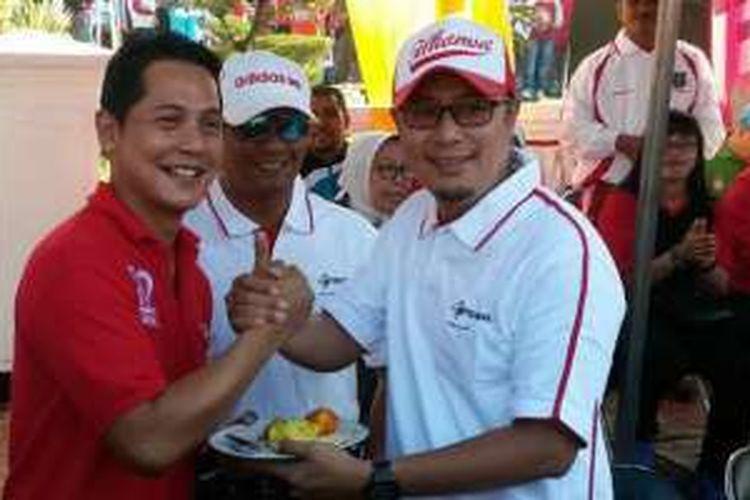 Manager Branch Bogor Fahmy Rojali (kiri) bersama Wakil Walikota Sukabumi, H. Achmad Fahmi,S.Ag, M.M (kanan), saat meresmikan layanan 4G LTE Telkomsel di Sukabumi