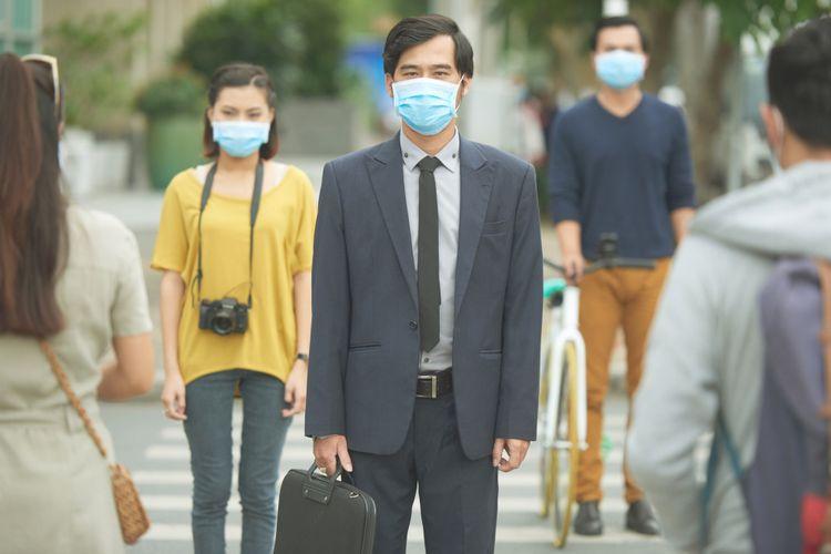 Ilustrasi orang memakai masker
