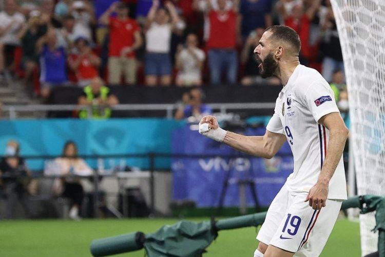 Selebrasi penyerang timnas Perancis, Karim Benzema, seusai mencetak gol dari titik penalti seusai laga Grup F antara Portugal vs Perancis di Puskas Arena, Budapest, Rabu (23/6/2021) atau Kamis dini hari WIB.