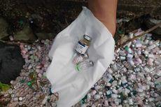 Jarum Suntik dan Ratusan Botol Limbah Medis Dibuang Berserakan di Selokan