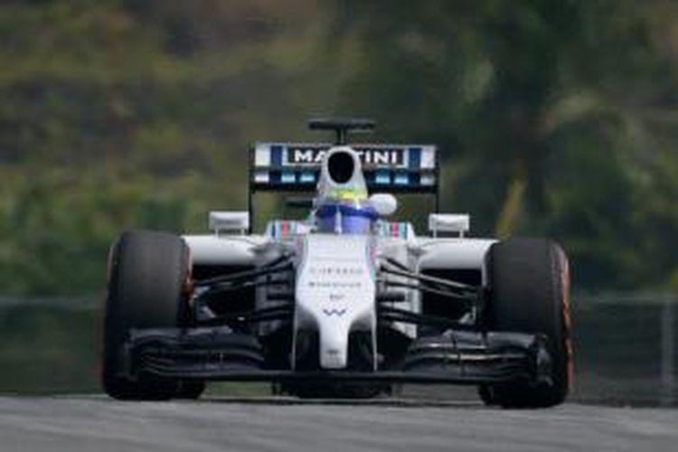 Pebalap Williams asal Brasil, Felipe Massa, memacu mobilnya pada sesi latihan GP Malaysia di Sirkuit Sepang, Jumat (28/3/2014).