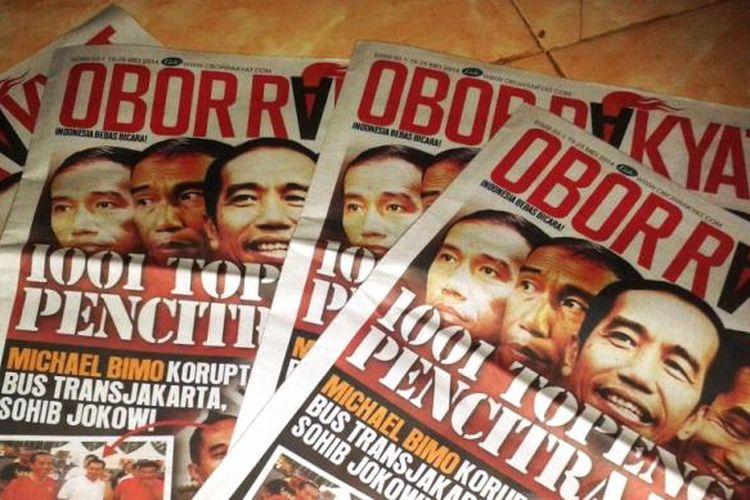 Sehari sebelum pemungutan suara, Warga Kabupaten Jember, Jawa Timur, mendapat kiriman tabloid Obor Rakyat, Selasa (8/7/2014).