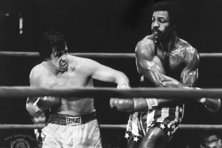 Pertandingan antara Sylvester Stallone dengan Carl Weathers dalam Rocky.