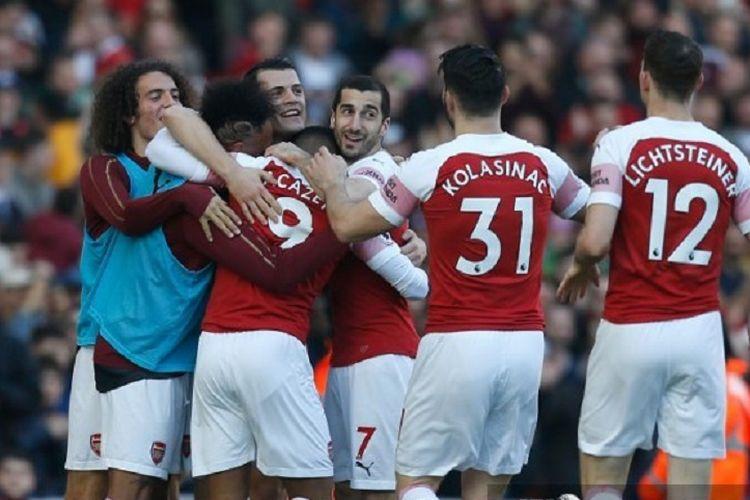 Para pemain Arsenal berselebrasi seusai Alexandre Lacazette mencetak gol dalam laga melawan Southampton di Liga Inggris, 24 Februari 2019.