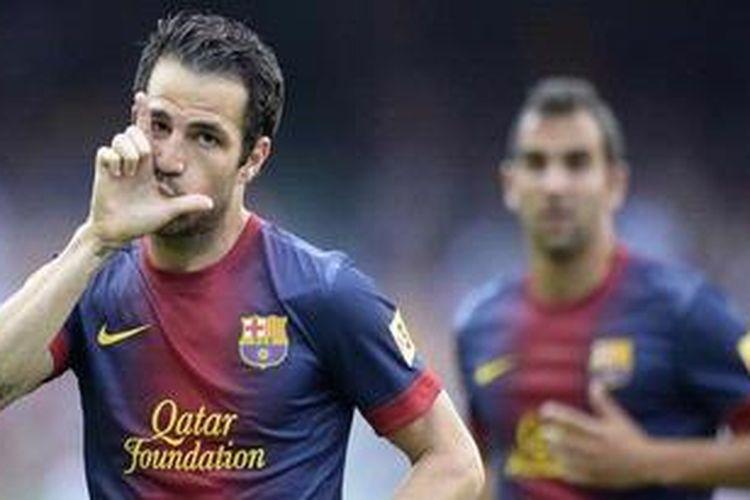Selebrasi Cesc Fabregas usai membobol gawang Malaga dalam lanjutan Liga BBVA, Sabtu atau Minggu (2/6/2013) dini hari WIB.