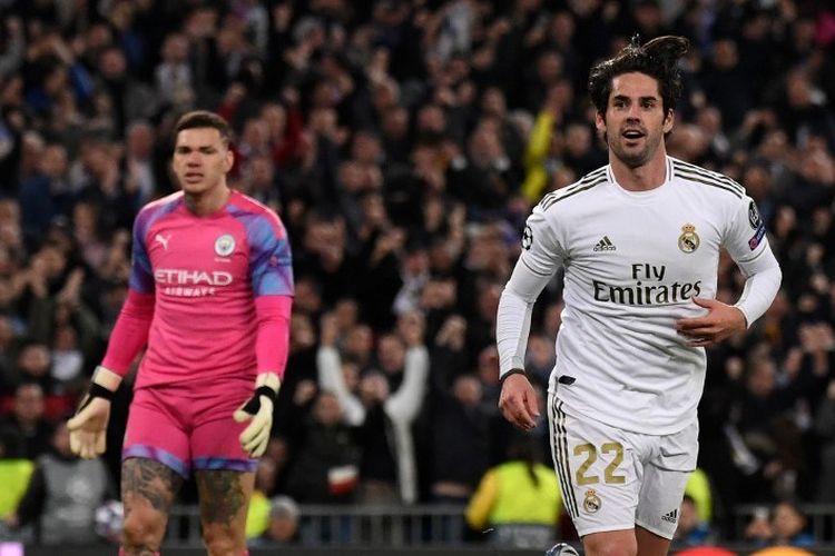 Gelandang Spanyol Real Madrid Isco merayakan golnya dalam pertandingan leg pertama babak 16 besar Liga Champions UEFA antara Real Madrid CF dan Manchester City di stadion Santiago Bernabeu di Madrid pada 26 Februari 2020.