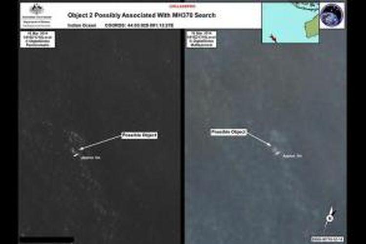 Foto satelit menunjukkan 2 objek yang diduga puing pesawat Malaysia Airlines. Pemerintah Australia, Kamis (20/3/2014), mengumumkan temuan dua obyek yang diduga berhubungan dengan pesawat Malaysia Airlines yang hilang sejak Sabtu (8/3/2014).
