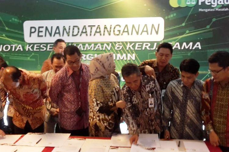 Kerjasama antara PT Pegadaian (Persero) dengan 10 BUMN di Kementerian BUMN, Jakarta, Senin (30/9/2019)
