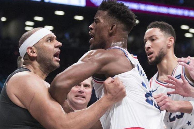 Dua pemain klub NBA Divisi Atlantik, Jimmy Butler dari Philadelhia 76ers dan Jared Dudley dari Brooklyn Nets dijatuhi hukuman denda karena terlibat perkelahian.