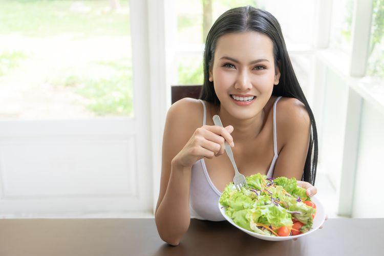 Ilustrasi makan sayuran