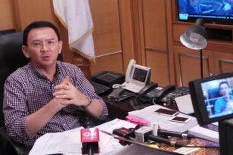 Gubernur DKI Jakarta Basuki Tjahaja Purnama di ruang kerjanya di Balai Kota, Sabtu (21/11/2015).