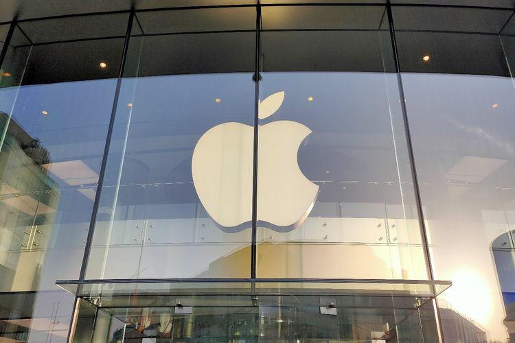 Ilustrasi logo Apple di depan Apple Store Beijing