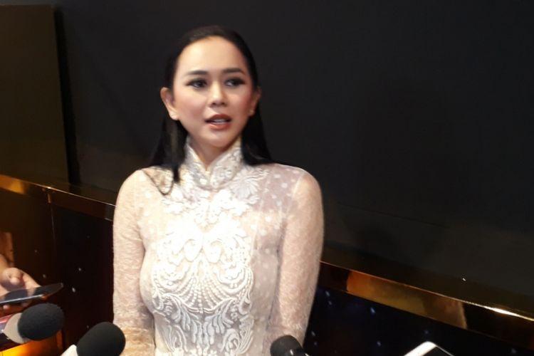 Aura Kasih menghadiri ajang Indonesia Movie Actors Awards 2018 di MNC Studio Tower II, Jakarta Barat, Rabu (4/7/2018) malam.