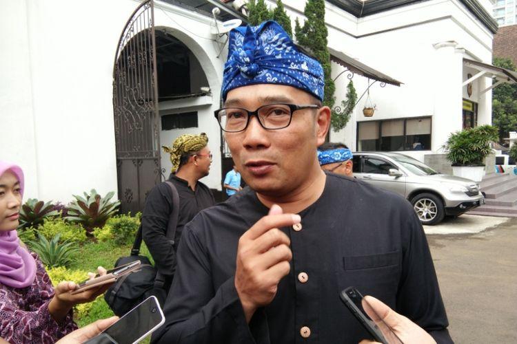 Wali Kota Bandung Ridwan Kamil saat ditemui usai menghadiri rapat koordinasi pengamanan Natal dan Tahun Baru di Mapolrestabes Bandung, Jalan Jawa, Rabu (13/12/2017).
