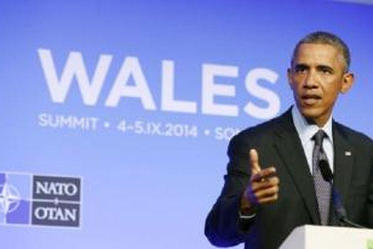 Presiden AS Barack Obama berbicara dalam KTT NATO di Resor Celtic Manor, Newport, Wales (5/9/2014).