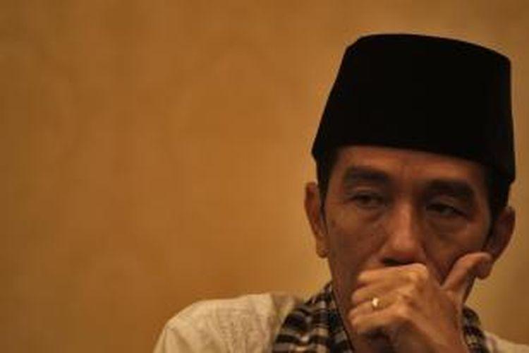 Gubernur DKI Jakarta, Joko Widodo ketika menghadiri rapat koordinasi regional II perumahan dan kawasan permukiman tahun 2013 di Hotel Sultan, Jakarta Selatan, Jumat (15/3/2013).