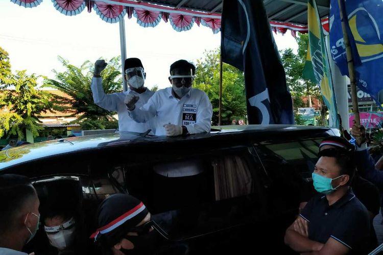 Pasangan Machfud Arifin - Mujiaman mendaftar ke KPU Surabaya dilepas putra Dahlan Iskan, Azrul Ananda, Minggu (6/9/2020) sore.